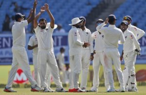 Indian players celebrate the wicket of England's batsman Jonny Bairstow during the second day of the first test cricket match between India and England in Rajkot, India, Thursday, Nov. 10, 2016. (AP Photo/Rafiq Maqbool)