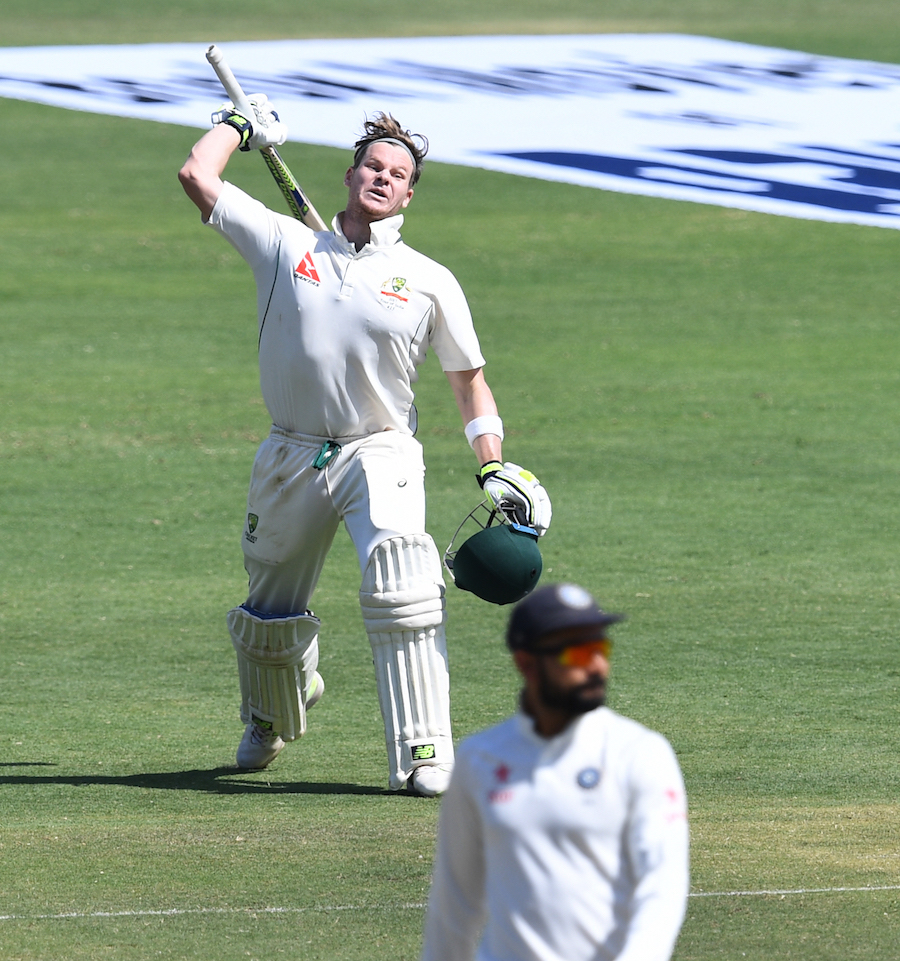Australia's captain Steve Smith celebrates after scoring a century (100 runs) on the third day of the first cricket Test match between India and Australia at The Maharashtra Cricket Association Stadium in Pune on February 25, 2017. ----IMAGE RESTRICTED TO EDITORIAL USE - STRICTLY NO COMMERCIAL USE----- / GETTYOUT / AFP PHOTO / INDRANIL MUKHERJEE / ----IMAGE RESTRICTED TO EDITORIAL USE - STRICTLY NO COMMERCIAL USE----- / GETTYOUT