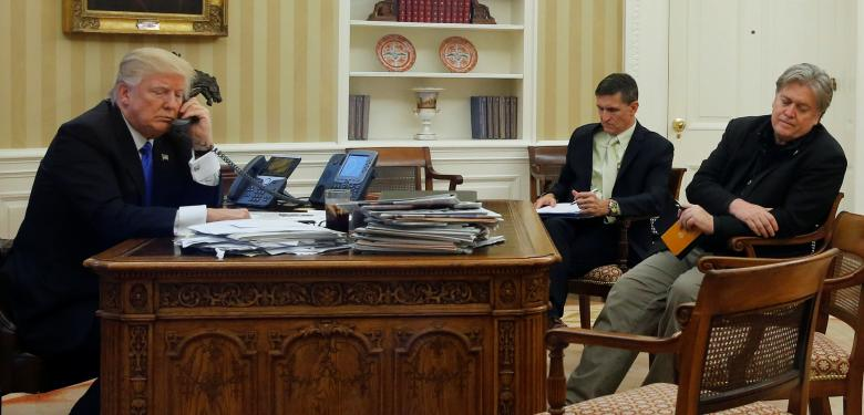 U.S. President Donald Trump (L), seated at his desk with National Security Advisor Michael Flynn (2nd R) and senior advisor Steve Bannon (R), speaks by phone with Australia's Prime Minister Malcolm Turnbull in the Oval Office at the White House in Washington, U.S. January 28, 2017. REUTERS/Jonathan Ernst