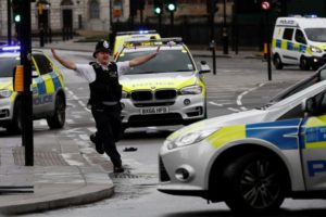 A police officer gestures outside Parliament during an incident on Westminster Bridge in London