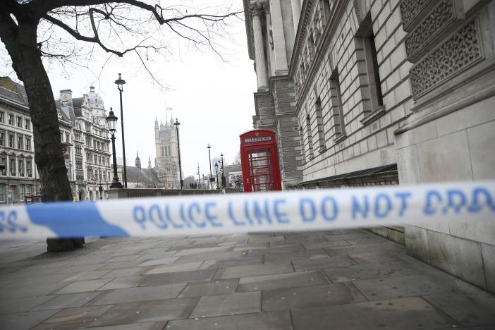 Police tape blocks access to Parliament Square the morning after an attack by a man driving a car and weilding a knife left five people dead and dozens injured, in London