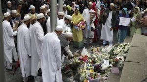 People lay flowers after a vigil for victims of Saturday's attack in London Bridge, at Potter's Field Park in London, Monday, June 5, 2017. Police arrested several people and are widening their investigation after a series of attacks described as terrorism killed several people and injured more than 40 others in the heart of London on Saturday. (AP Photo/Tim Ireland)